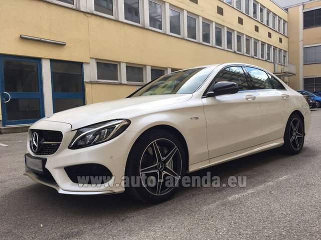 Hire and delivery to Memmingen airport the car Mercedes-Benz C-Class C43 AMG Biturbo 4MATIC White