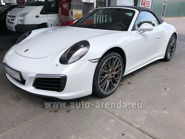 Hire and delivery to Memmingen airport the car: Porsche 911 Carrera 4S Cabrio White